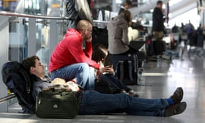 Delayed passengers wait at Heathrow Airport