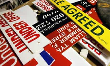 A collection of 'sale agreed' for sale signs