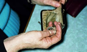 A woman counting coins from her purse