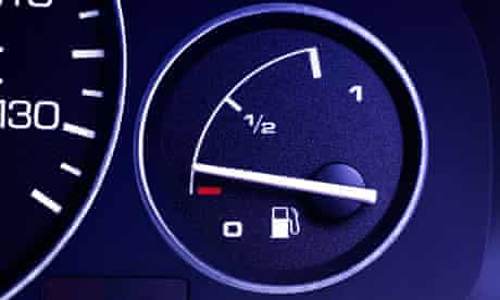 A car dashboard showing a speedo and fuel gauge