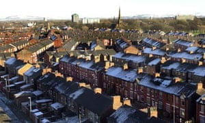 A row of houses with frost on the roofs