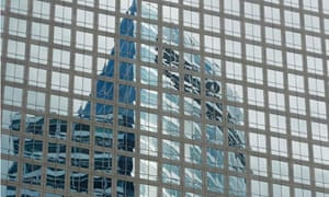 Goldman Sachs HQ is reflected in the windows of a neighboring building in New York