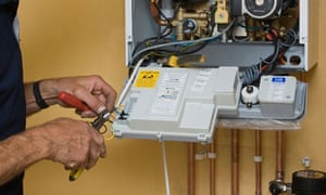 A man working on a gas boiler.