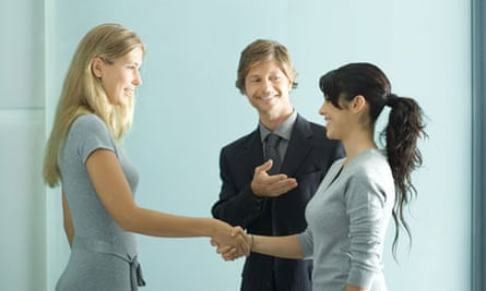 An intern being introduced to full-time colleagues
