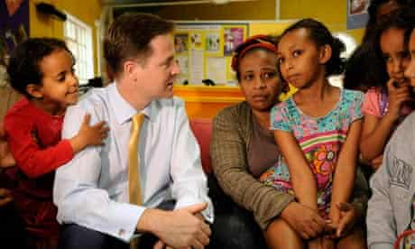 Nick Clegg with a mother and her child