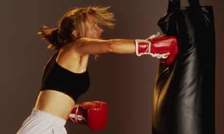 A woman punching a punch bag