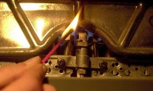 A match lighting a boiler flame