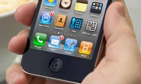 A man holding an iPhone 4