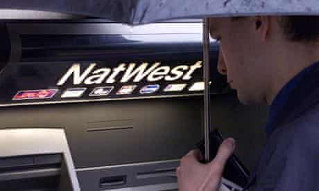 A man using a NatWest ATM