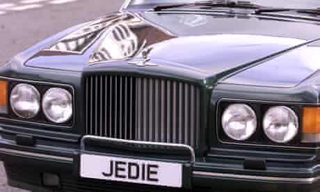 The radiator of a Bentley luxury car with a personalised numberplate