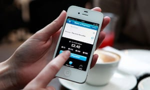 Barclays Pingit app running on a smartphone being used in a coffee shop