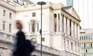 A business woman outside the Bank of England