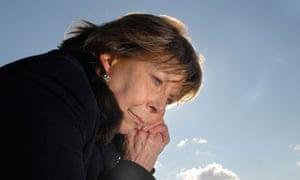 An older woman looking worried