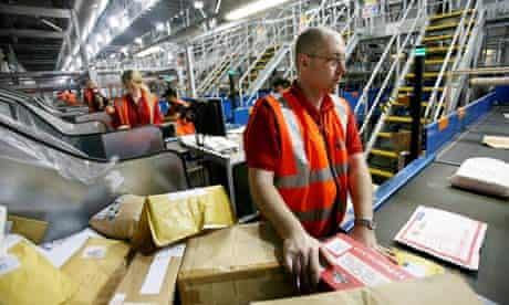 Postal workers sort packages