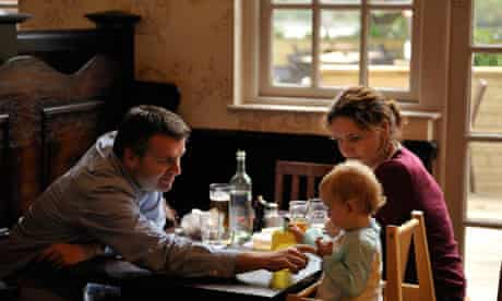 A young family dines at a pub in Fulham, London