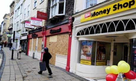 City centre premises boarded up in York, apart from a Money Shop