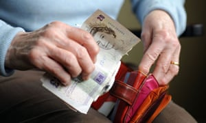 A female old aged pensioner holding money