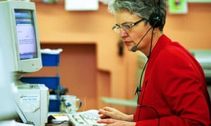 Older woman using a computer and telephone headset