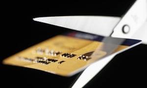Scissors cutting up credit card