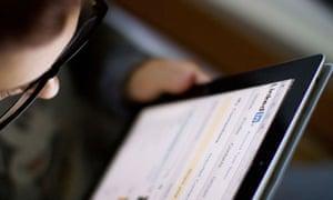 Someone using LinkedIn on an iPad