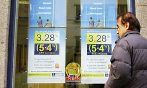 A man looks at mortgage rates in the window of a Norwich and Peterborough Group branch