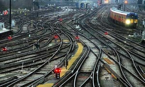 Railway tracks and a train pulling into Clapham Junction