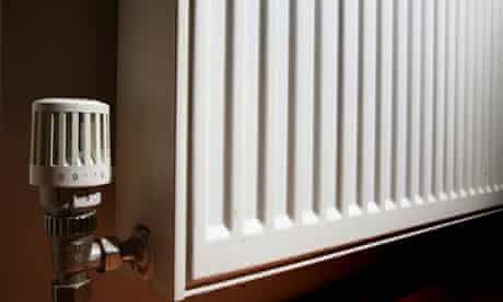 Close up shot showing thermostat knob at the edge of a household radiator