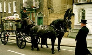 A horse drawn hearse at a funeral