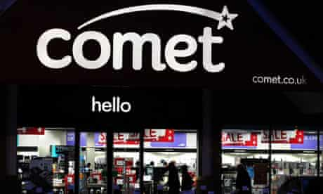 A Comet store illuminated at night