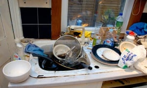 A filthy kitchen sink with dirty dishes
