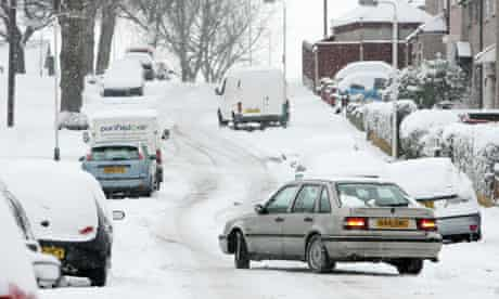 A car struggles in icy conditions