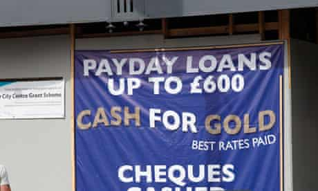 A sign for payday loans and cash for gold in a UK city