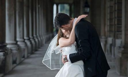 A married couple share a kiss