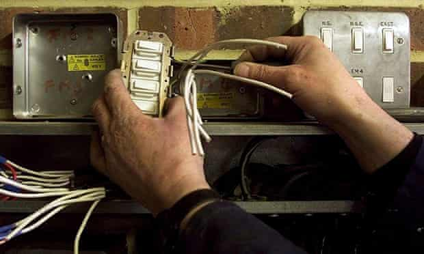 An electrician repairing some wires
