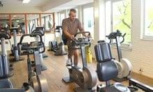 Man fitness training in sports club