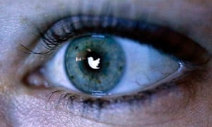 An illustration picture shows the Twitter logo reflected in an eye
