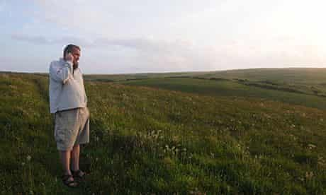 Man talking on a mobile phone in a field