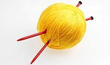 Ball of yellow knitting wool
