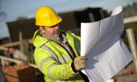 Construction worker looking at plan