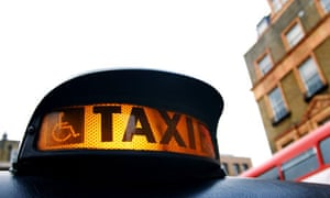 A taxi with its light on