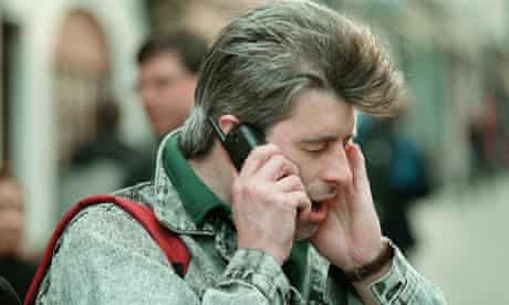 Man screaming on mobile phone