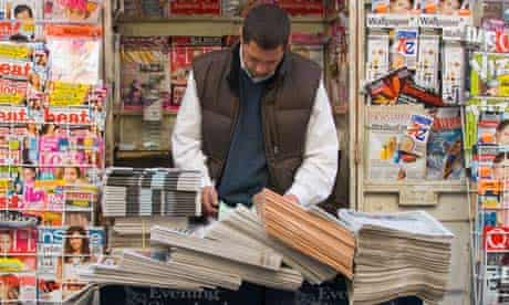 Newspaper seller in a London street