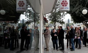 People queue outside Laiki Bank in Nicosia, Cyprus