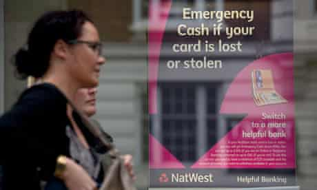 A woman walks past a Natwest bank branch