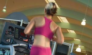A woman Jogging on a gym treadmill