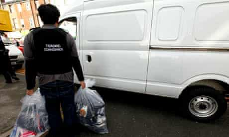 A Trading Standards officer seizing goods in Liverpool