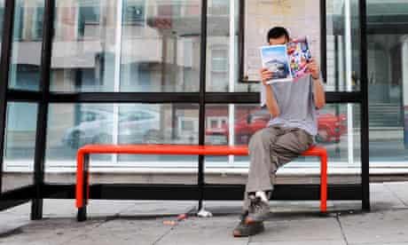 A man reading a magazine