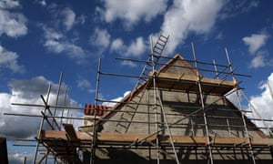 Scaffolding surrounds a newly built house as it nears completion in Suffolk