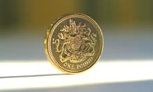 A £1 coin in a shaft of light