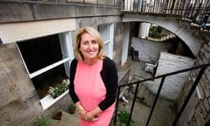Sue Mullen outside her home in Edinburgh